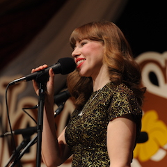 Caption: Rachael Price of Lake Street Dive on the WoodSongs Stage.