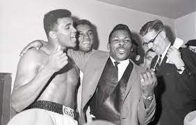 Caption: Lloyd Price with Muhammad Ali