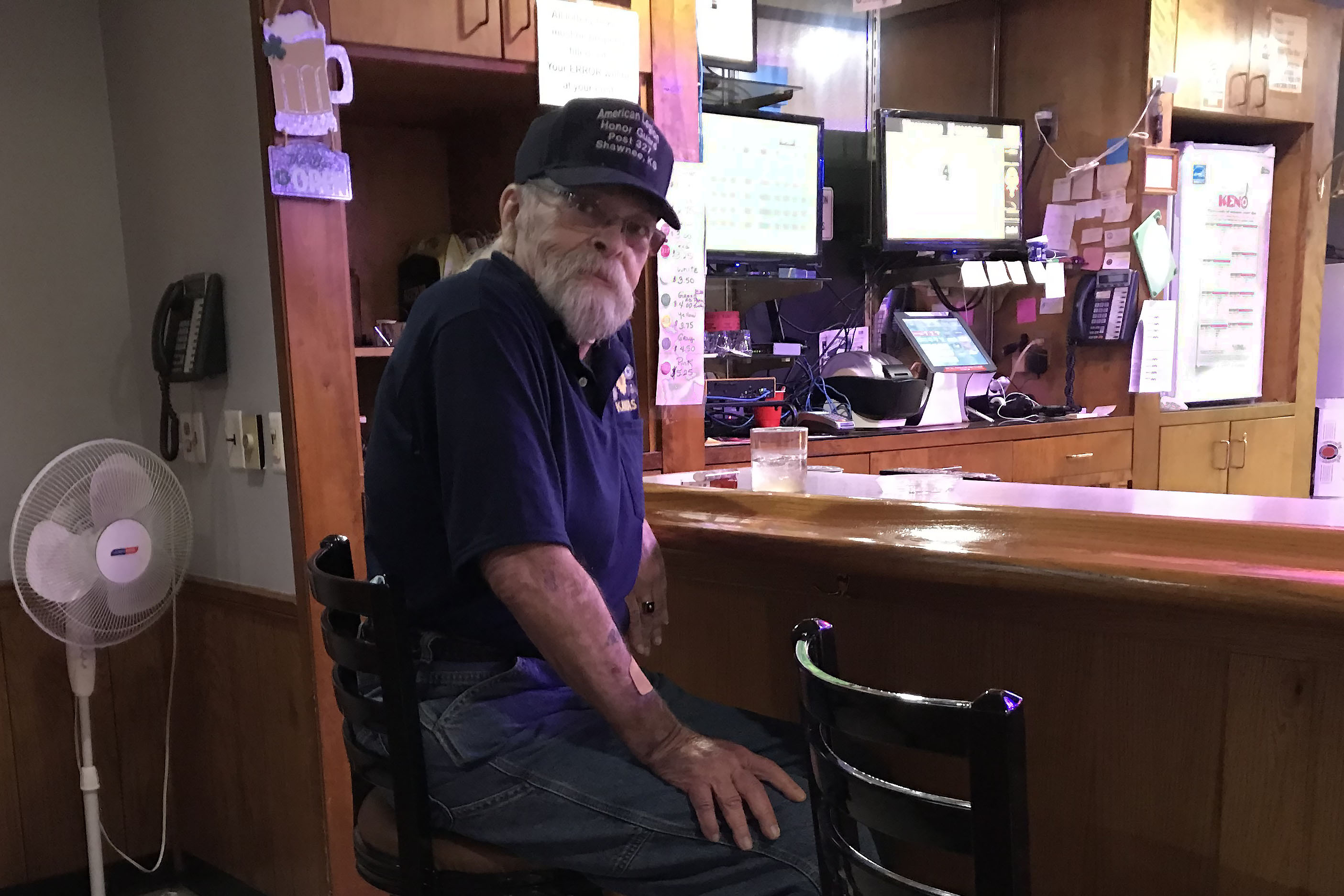 Caption: Richard Sobek, the Commander of American Legion Post 327 in Shawnee, Kansas, sits at the post's basement bar. The post is struggling to recover financially after being closed several months during the pandemic., Credit: Anne Kniggendorf / American Homefront