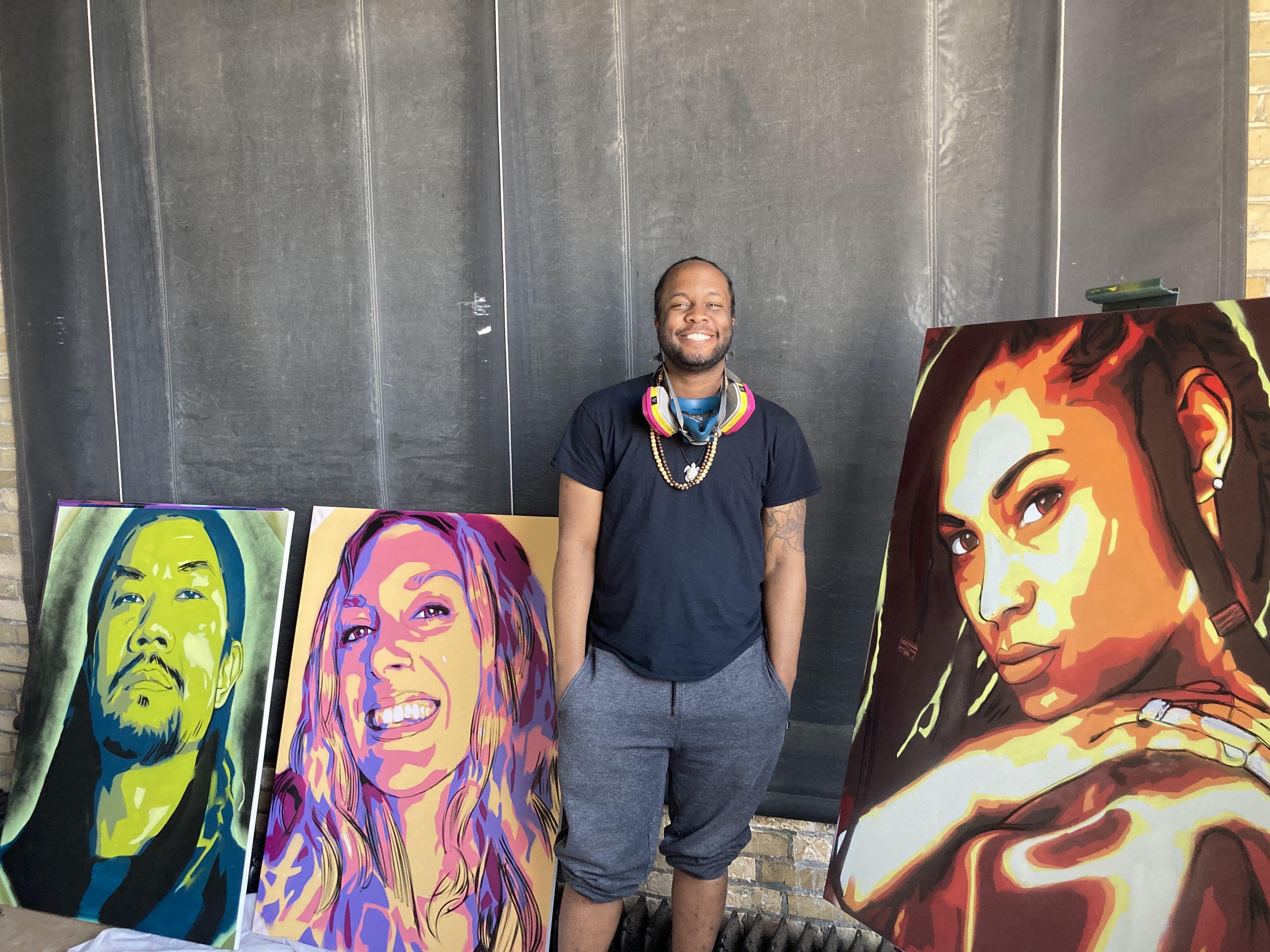 Caption: Minnesota artist Reggie LeFlore poses among his paintings. , Credit: Sheila Regan