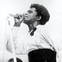 Caption: James Brown on stage in 1964, Credit: Getty