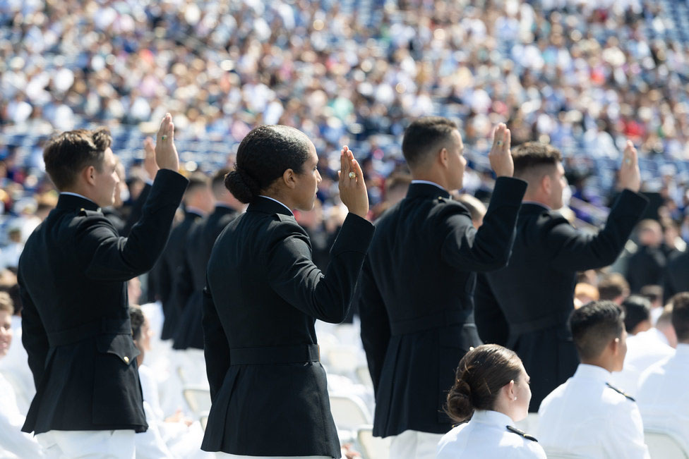 Caption: Members of the U.S. Naval Academy Class of 2021 take the oath of office to become Marine Corps second lieutenants during their May graduation and commissioning ceremony., Credit: Stacy Godfrey / U.S. Naval Academy