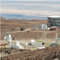 Caption: The Simons Array will be located in Chile's High Atacama Desert, at an elevation of about 17,000 feet. The site currently hosts the Atacama Cosmology Telescope (bowl-shaped structure at upper right) and the Simons Array (the three telescopes at bottom lef, Credit: University of Pennsylvania