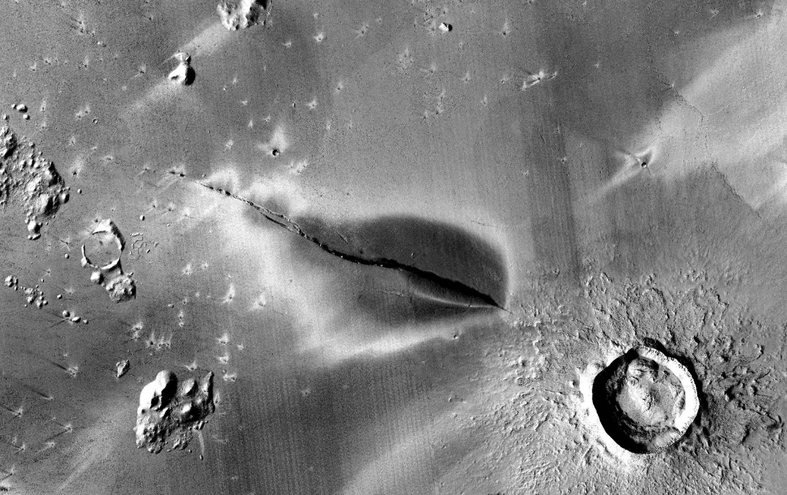 Caption: Recent explosive volcanic deposit around a fissure of the Cerberus Fossae system. , Credit: NASA/JPL/MSSS/The Murray Lab