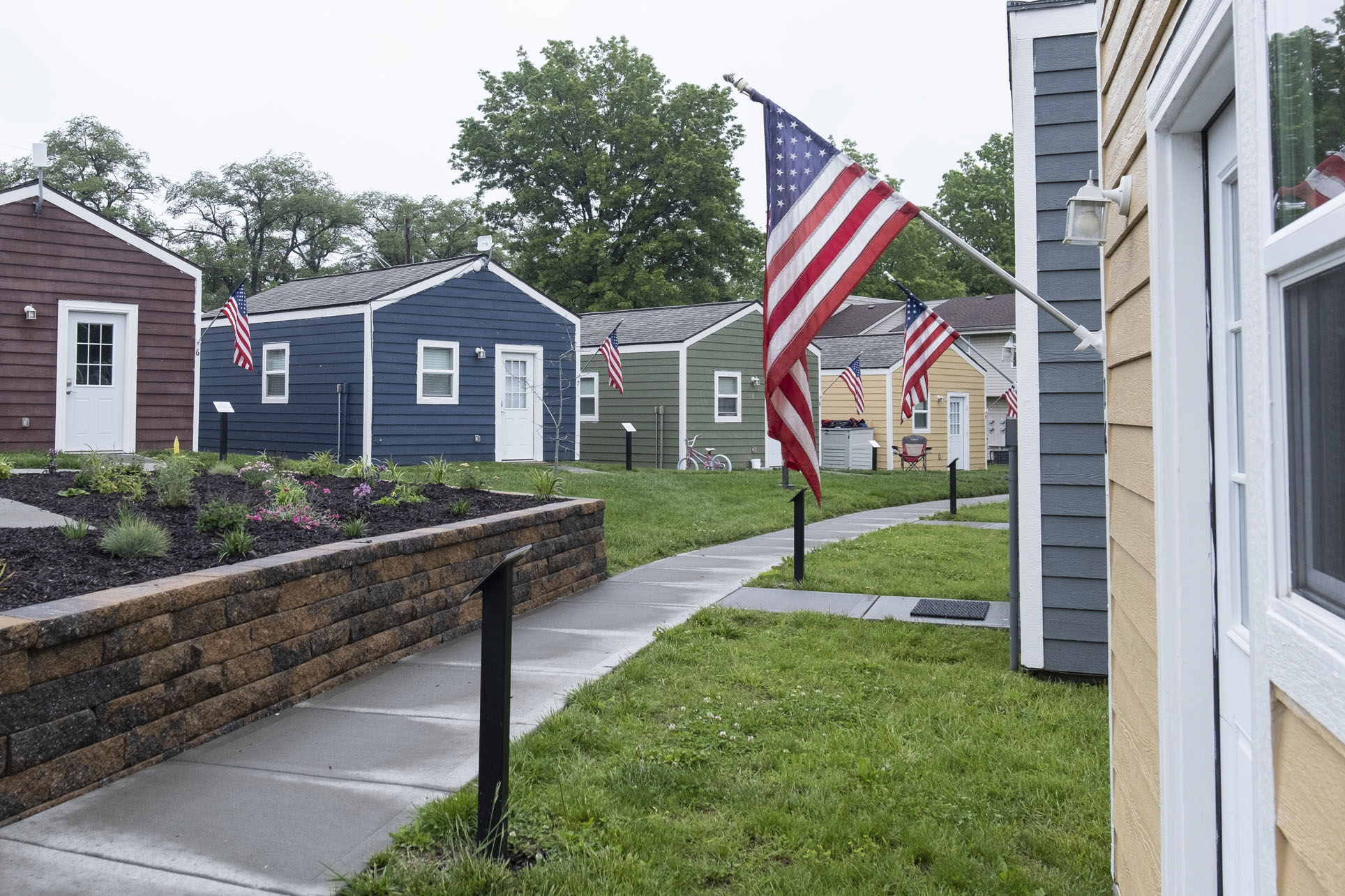 Caption: The first Veterans Community Project campus in Kansas City, Mo. features 49 tiny homes for homeless veterans. The organization hopes to have similar villages in eight cities by the end of 2022., Credit: Chris Haxel / American Homefront