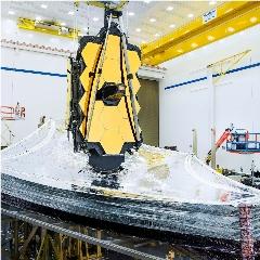 Caption: NASA's James Webb Space Telescope sits with its five-layer sunshield fully deployed during testing at Northrop Grumman in Redondo Beach, California., Credit: NASA/Chris Gunn