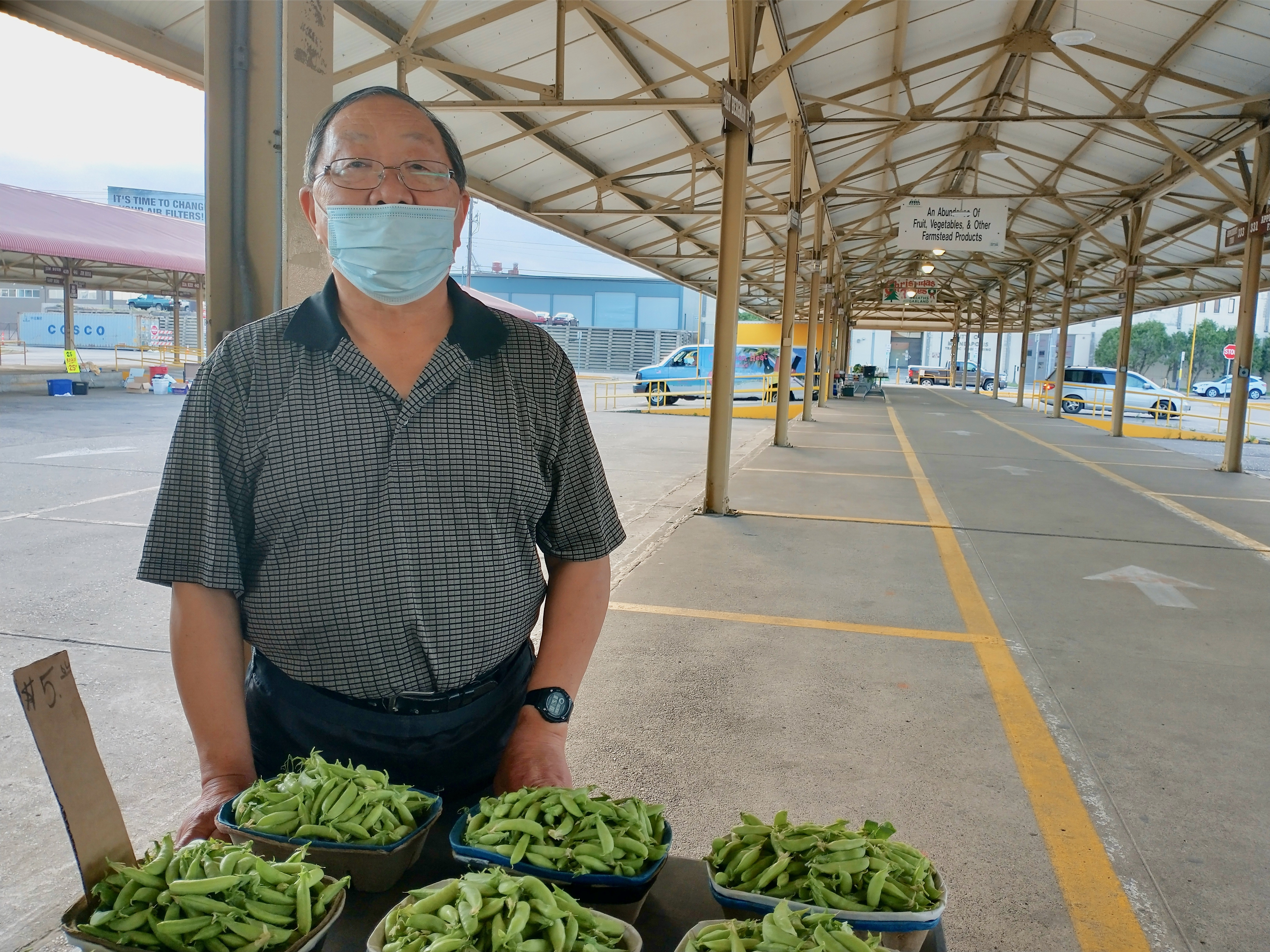 Caption: Hmong-American farmer You Pao Xiong stands near fresh produce at the Minneapolis Farmers Market., Credit: Mike Moen