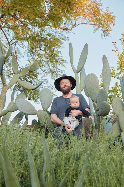Caption: David and son in home garden, Credit: images by Caitlin Atkinson, All Rights Reserved.
