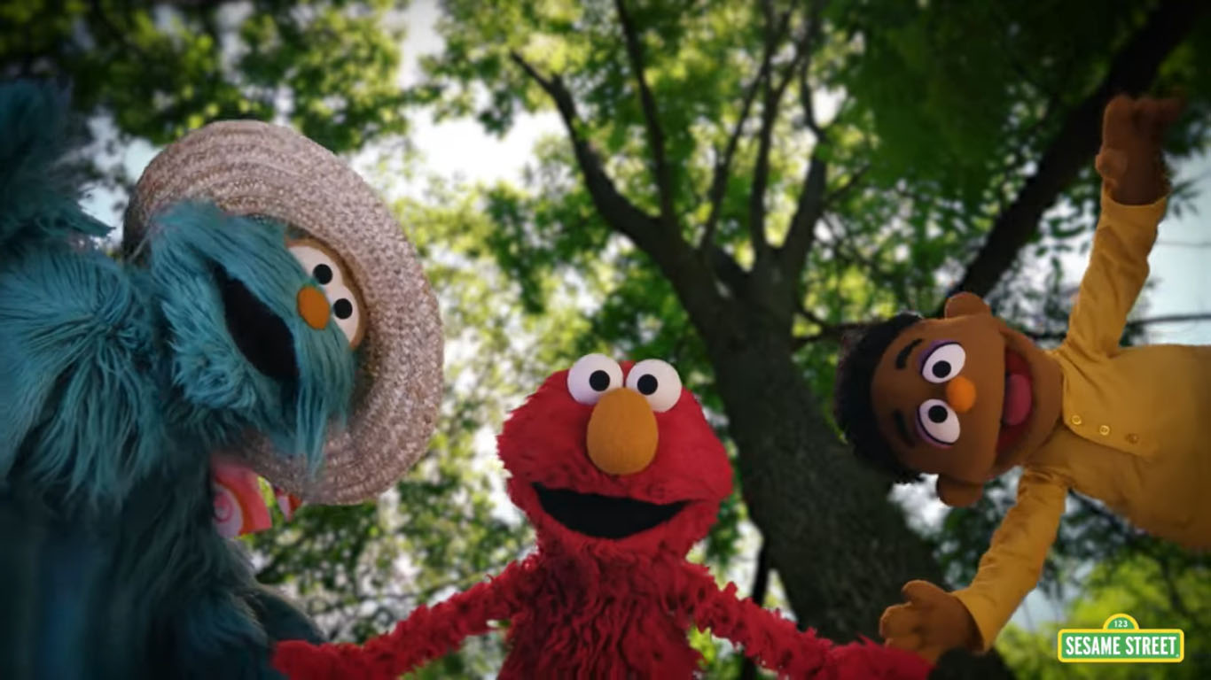 """Caption: Sesame Street characters Rosita, Elmo, and Wes perform in """"Great Things,"""" a music video about how to process the emotions that can occur after experiencing bias., Credit: Sesame Workshop"""