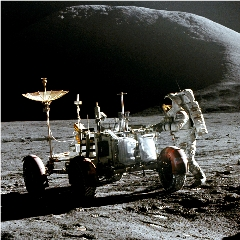 Caption: Jim Irwin with Apollo 15's Lunar Roving Vehicle. Developed in a breakneck 17 months, the LRV greatly extended the exploration range of final three Apollo missions., Credit: NASA/The Planetary Society