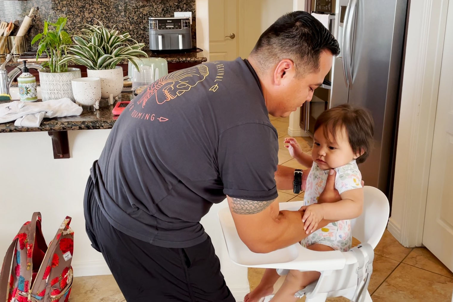 Caption: Former Marine Marcus Chischilly cares for his daughter at their San Diego home. Chischilly was a member of Darkhorse Battalion and lost his left leg in Afghanistan in 2010., Credit: Steve Walsh / American Homefront