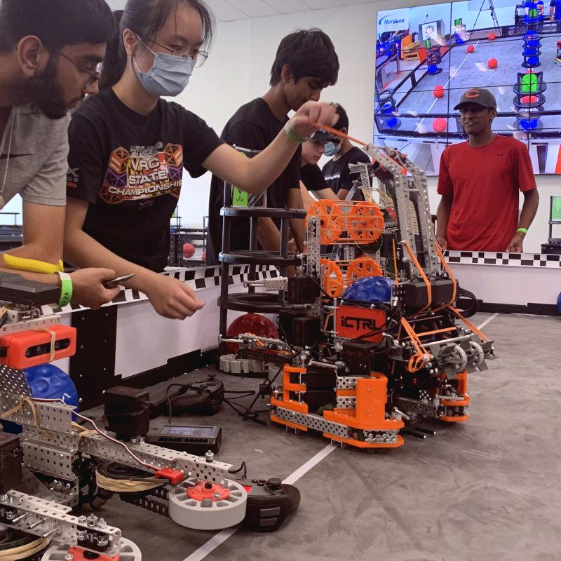 Caption: A student robotics team works on a robot., Credit: REC Foundation