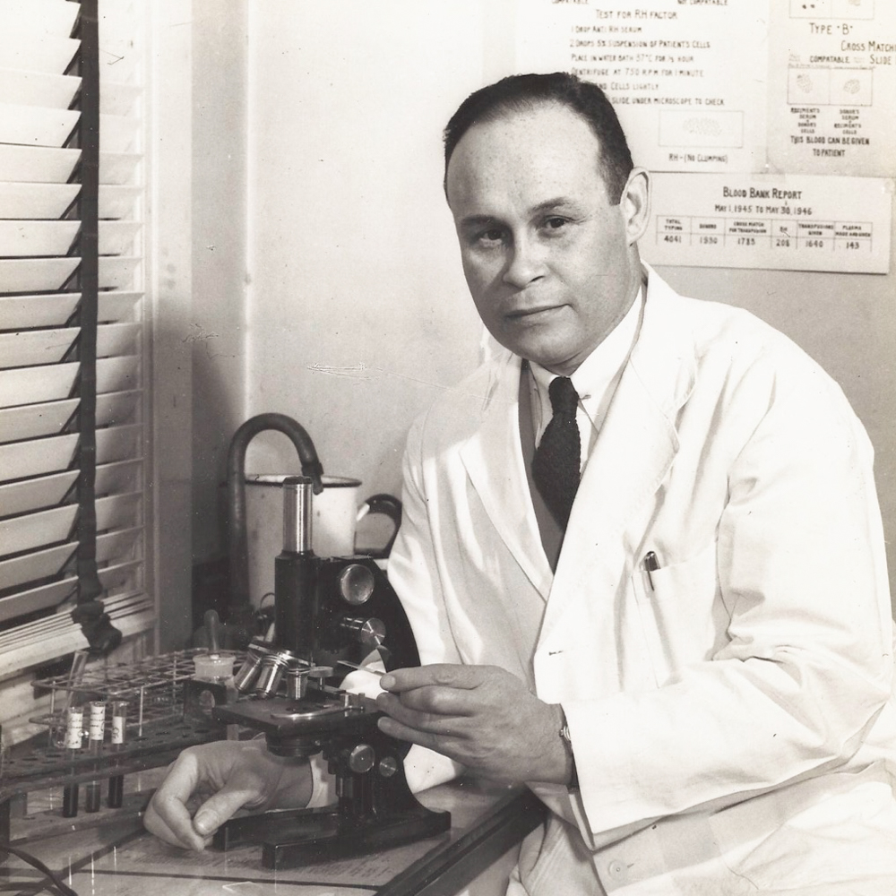 Caption: Dr. Charles Drew, pictured in a lab at Howard University in 1942, was known as the father of blood banking for pioneering the way we store and transport blood today., Credit: Dr. Charlene Jarvis