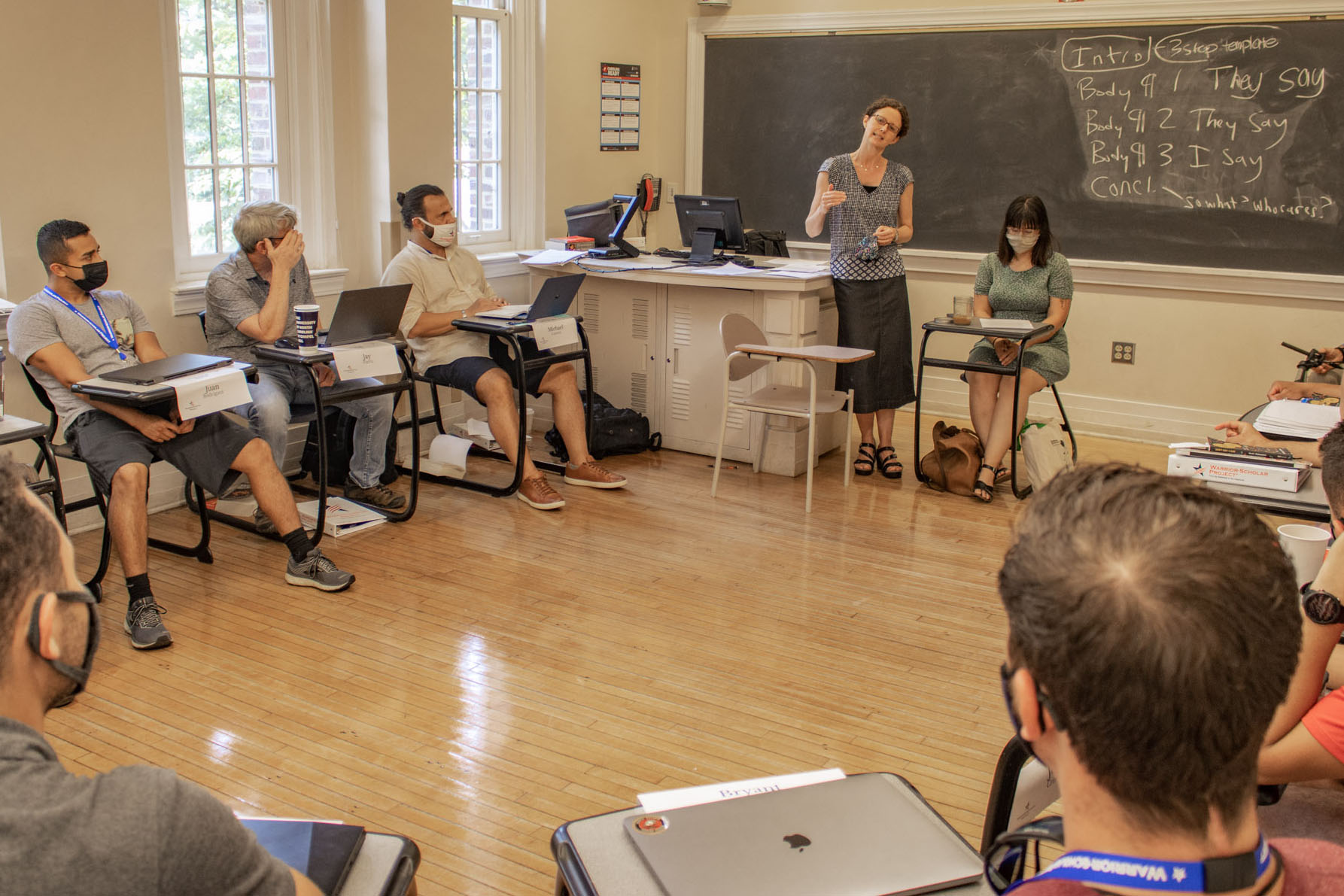 """Caption: English Professor Hilary Lithgow leads a discussion among about a dozen veterans and active-duty troops at the University of North Carolina-Chapel Hill during the Warrior-Scholar Project's 2021 """"Academic Boot Camp."""", Credit: Ira Wilder / UNC-Chapel Hill"""