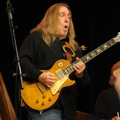 Caption: Greg Martin of The Kentucky Headhunters on the WoodSongs Stage.