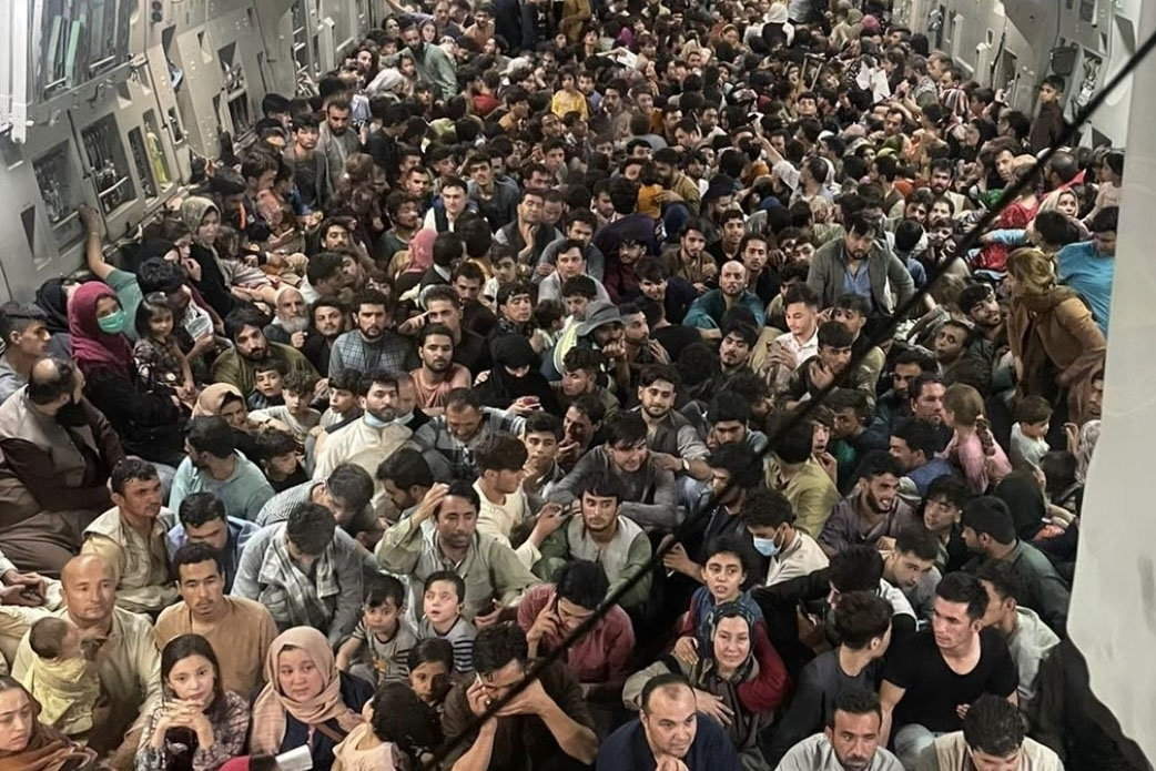 Caption: A U.S. Air Force C-17 carries evacuates about 600 Afghan citizens from Hamid Karzai International Airport in Kabul Aug. 15., Credit: U.S. Air Force