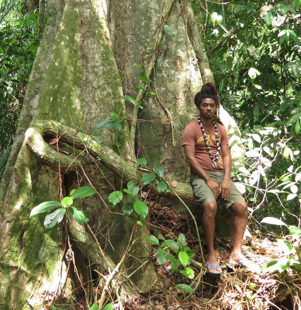 Caption: For The Cameroon-Cuba Connection, we talk to Georges Mbele, a nganga (healer) in the spiritual tradition of the Batanga people of south Cameroon, seen here in the sacred grove where the healing ceremonies take place., Credit: Ivor Miller (2021)