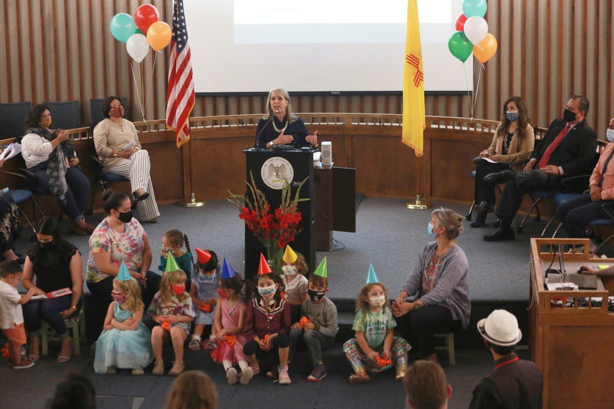 Caption: NM Gov. Michelle Lujan Grisham signs a bill for universal pre-k education