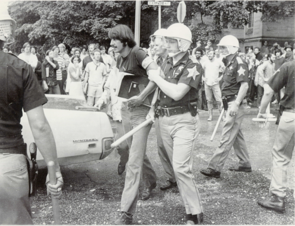 Caption: IU student Gregory Hess was arrested during a 1970 anti-war protest for shouting a statement urging a crowd of demonstrators to retake a street that police had just cleared. , Credit: Maurer School of Law