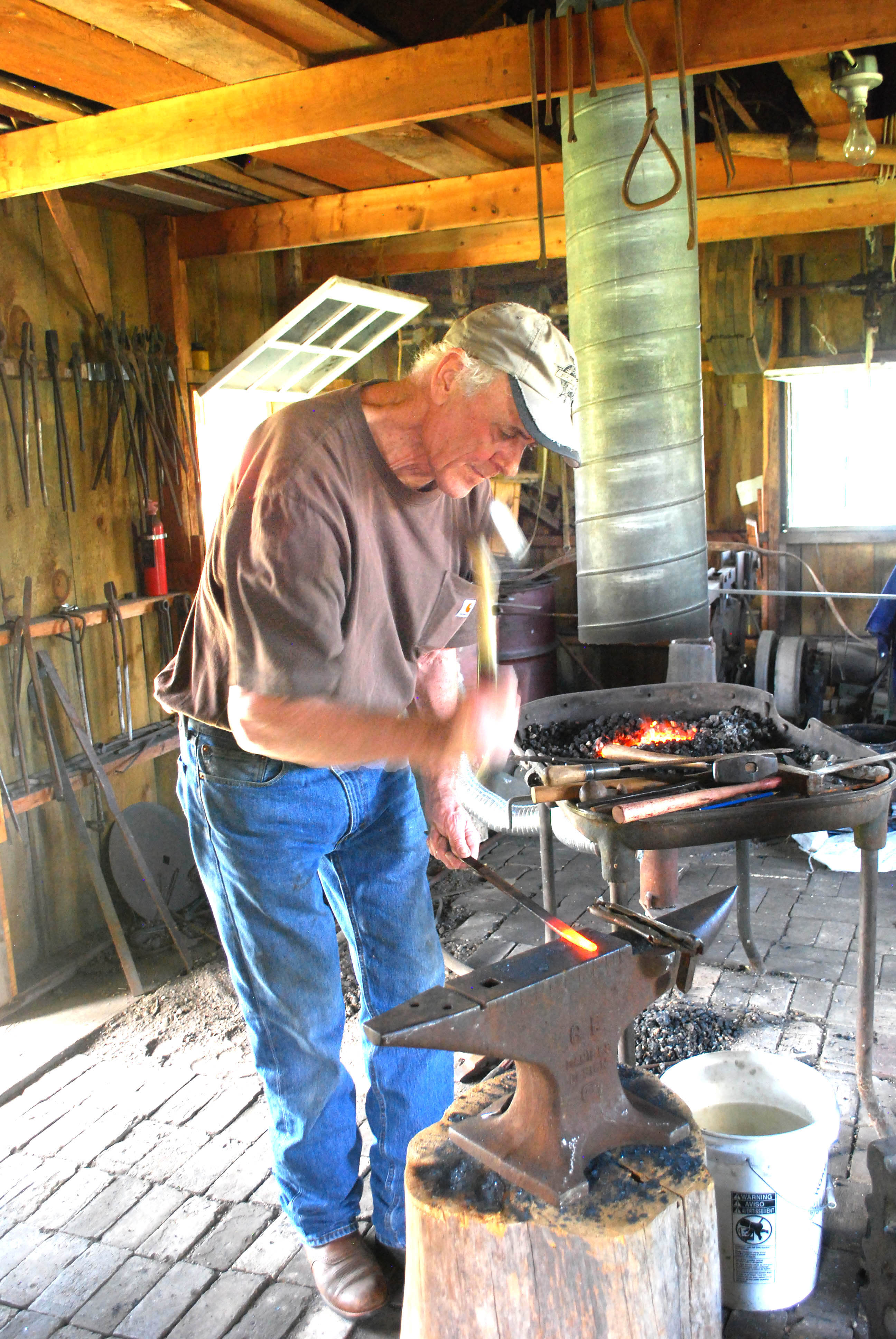 Caption: Randy Oberg of Grand rapids, MN - Professional Blacksmith