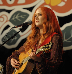 Caption: Grace Pettis on the WoodSongs Stage.