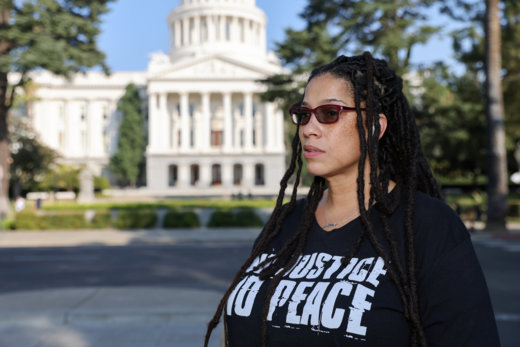 Caption: Alesha Monteiro, an advocate to those incarcerated, poses for a photo at the state Capitol in Sacramento, California, Credit: Sara Nevis