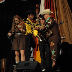 Caption: The Kody Norris Show on the WoodSongs Stage.