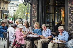 Caption: Diners study the menu at Café St. Régis on Ile Saint-Louis, Credit: Mina Carson/Dreamstime