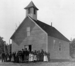 Caption: The St. Francis Xavier Catholic Church in the heart of Chippewa City, Credit: Cook County Historical Society