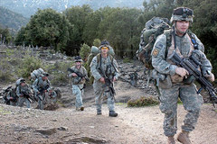 Caption: Army Pfc. Ronald Craig (R) and<br> fellow soldiers in 3rd Platoon,<br> Combat Company, 1-32 Infantry,<br> return from a two-week patrol <br>in Afghanistan., Credit: Army Spc. Jon H. Arguello