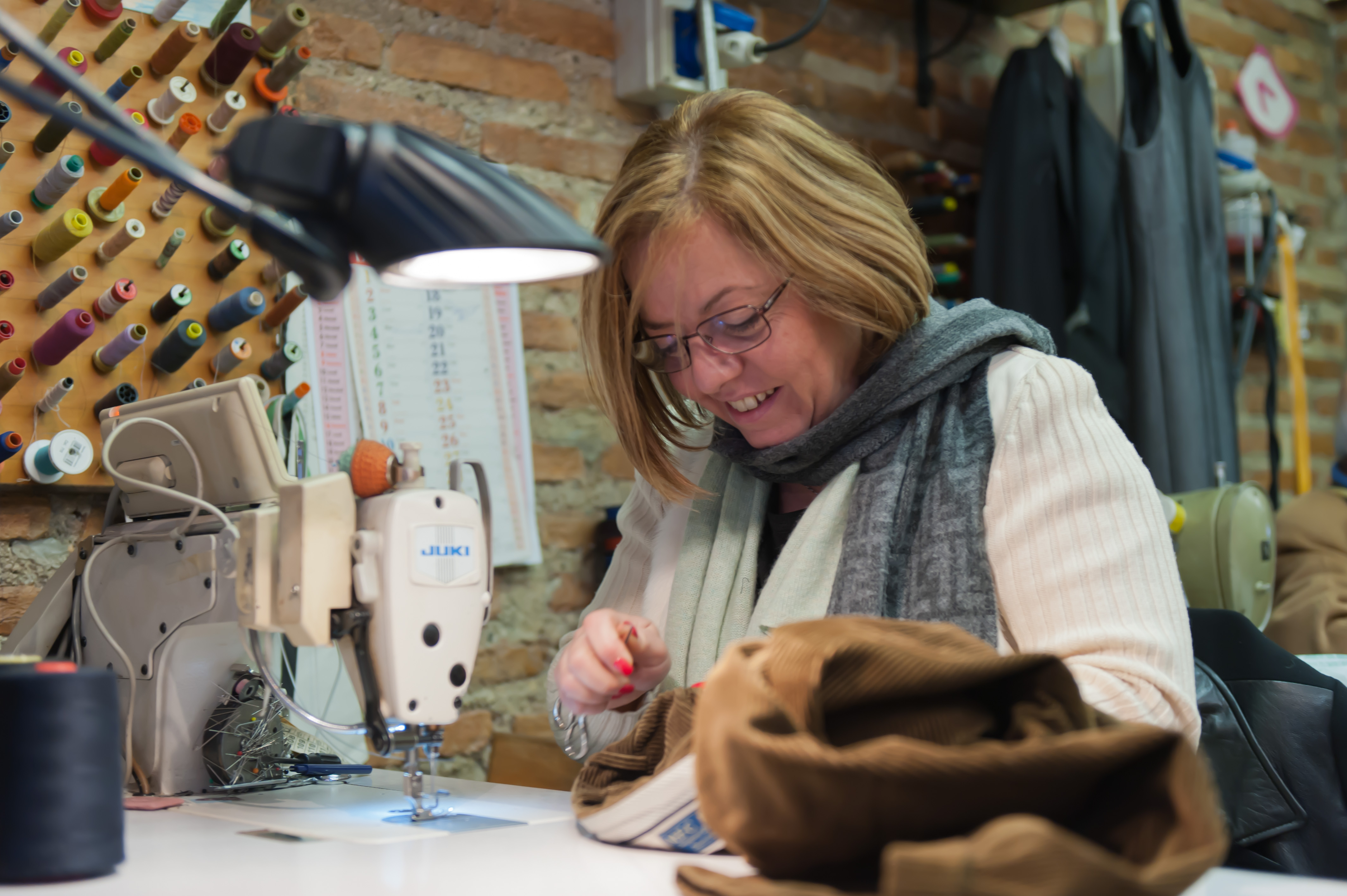 Caption: Tailor Paola Gueli<br/> has helped make Italy famous for<br/> its quality, handmade products<br/> but she is part of a disappearing breed., Credit: Luigi Fraboni