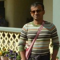 Caption: Sandip at the Grand Hotel in Nainital.