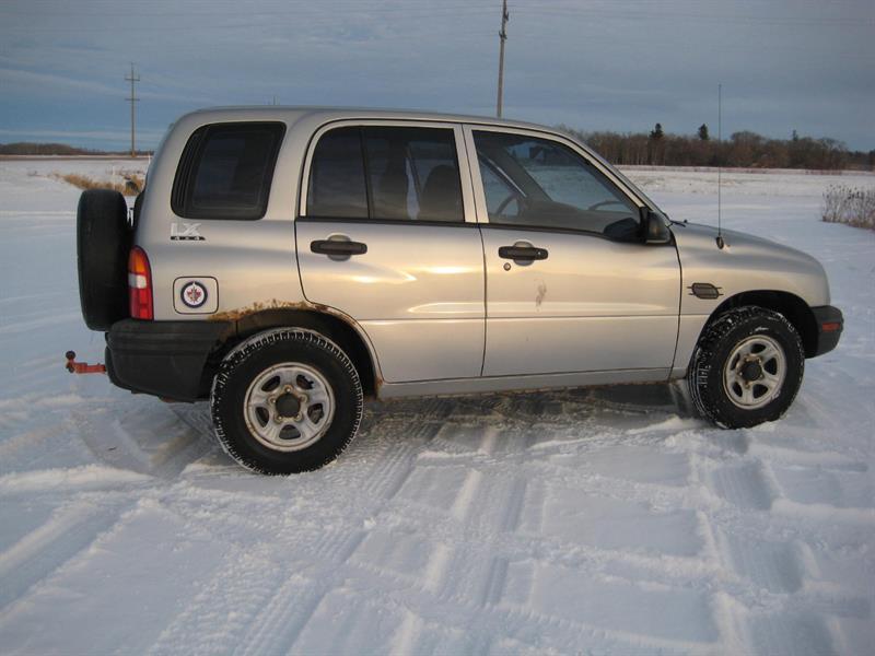 2003 Chevrolet Tracker #C-Caw