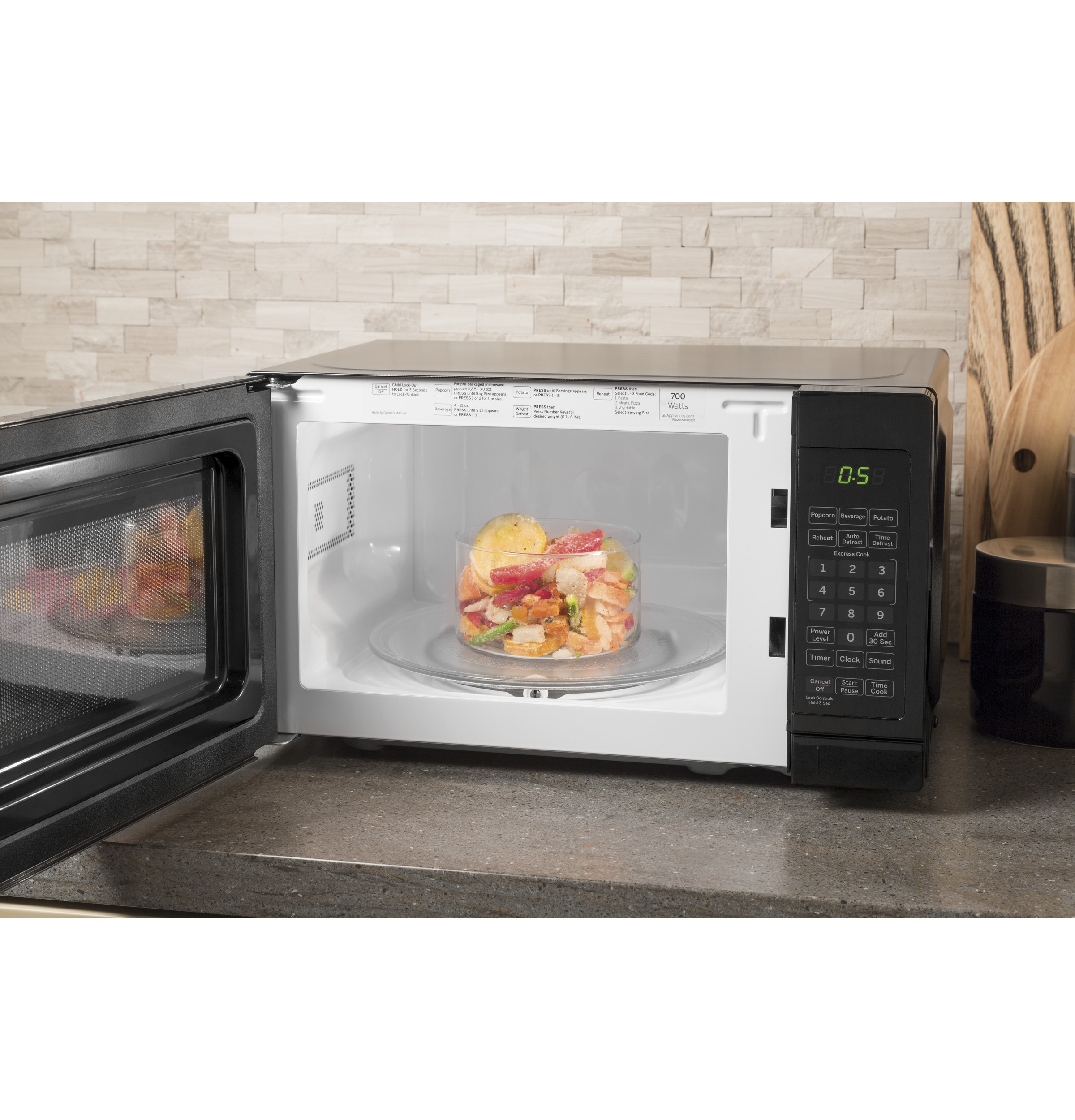 Model: JES1072DMBB | GE GE® 0.7 Cu. Ft. Capacity Countertop Microwave Oven