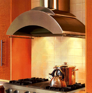 This wall mounted range hood with glass accents is designed for use over most professional-style cooking equipment.
