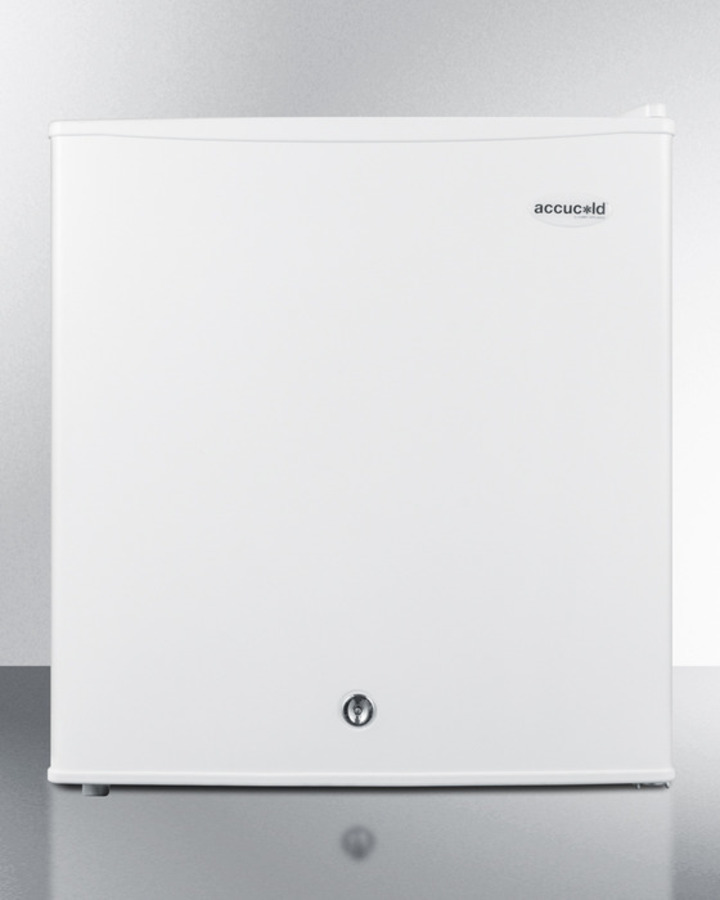 Compact refrigerator-freezer with front lock