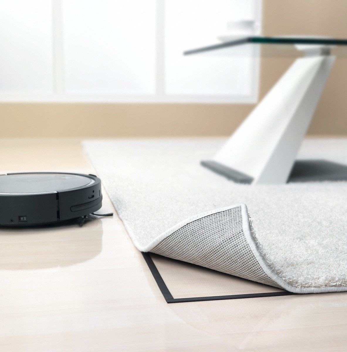 Magnetic strip defines areas that should not be cleaned by the robot vacuum cleaner