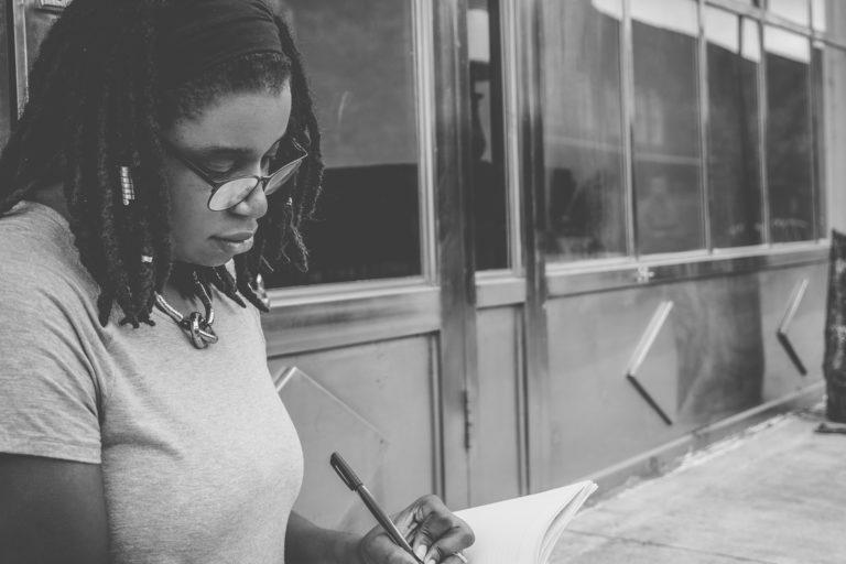 Writing Woman Photo by Eye for Ebony on Unsplash