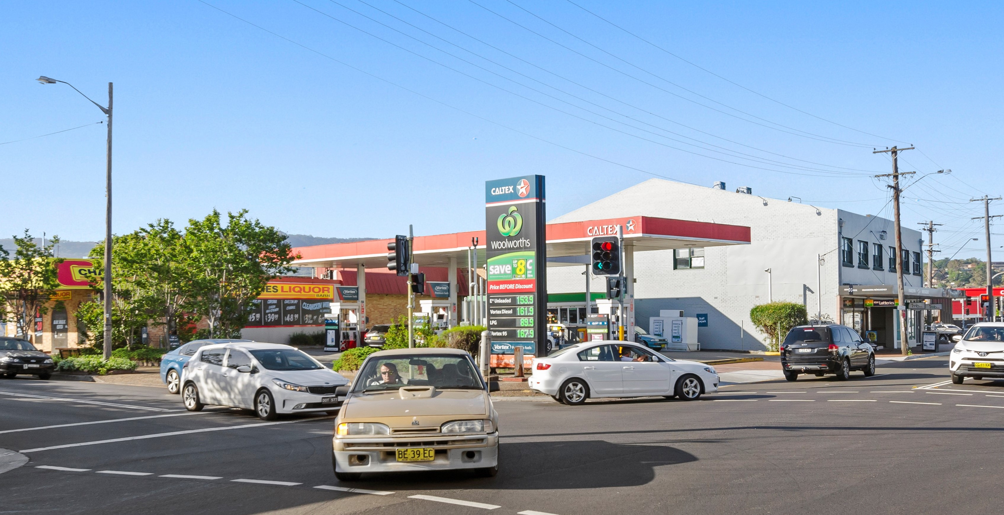 Freehold Busy Woolworths Service Station – 20 Year Lease & Opportunity for Major Income Growth
