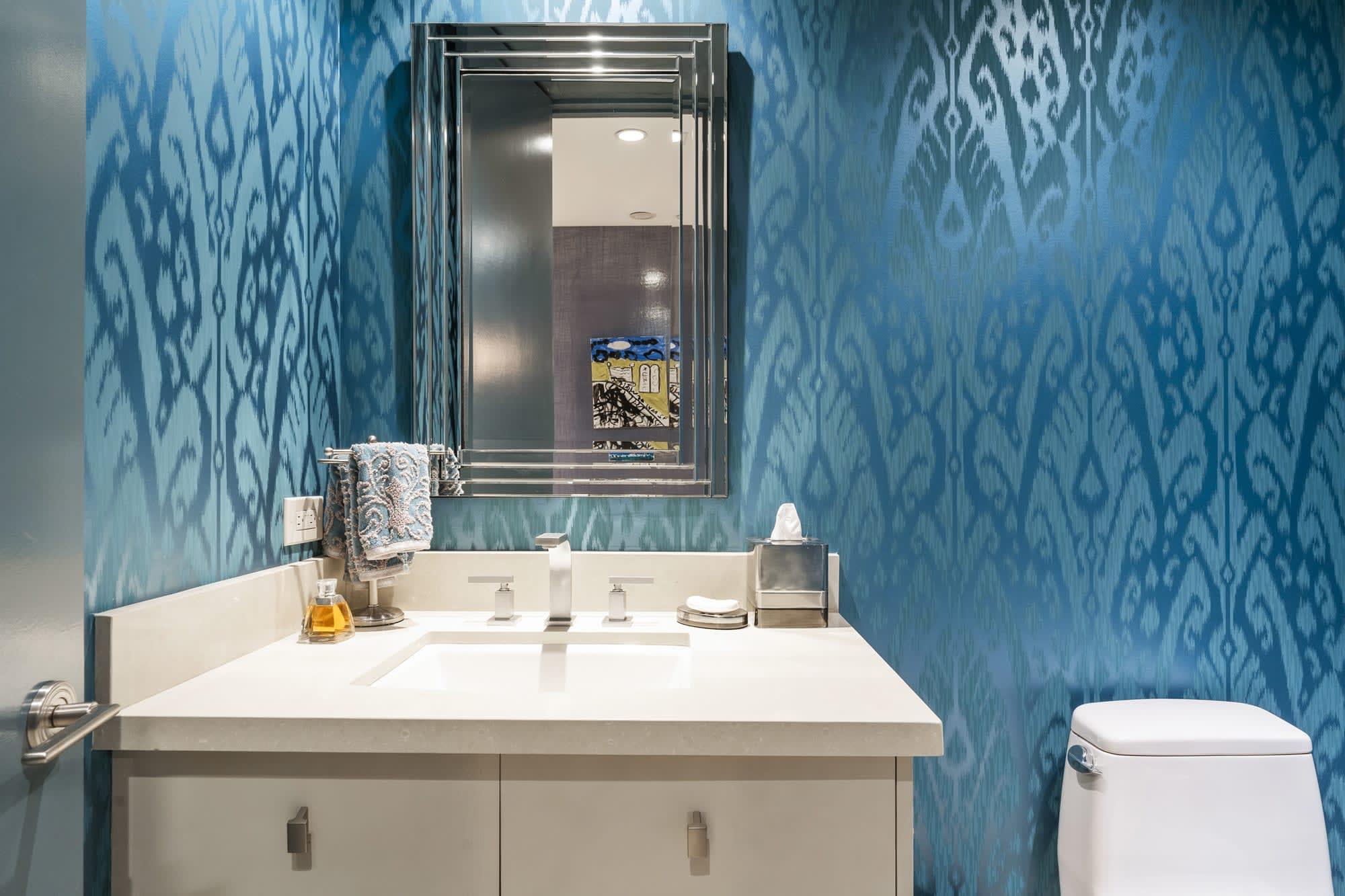 blue damask wallpaper in a sierra towers luxury condominium