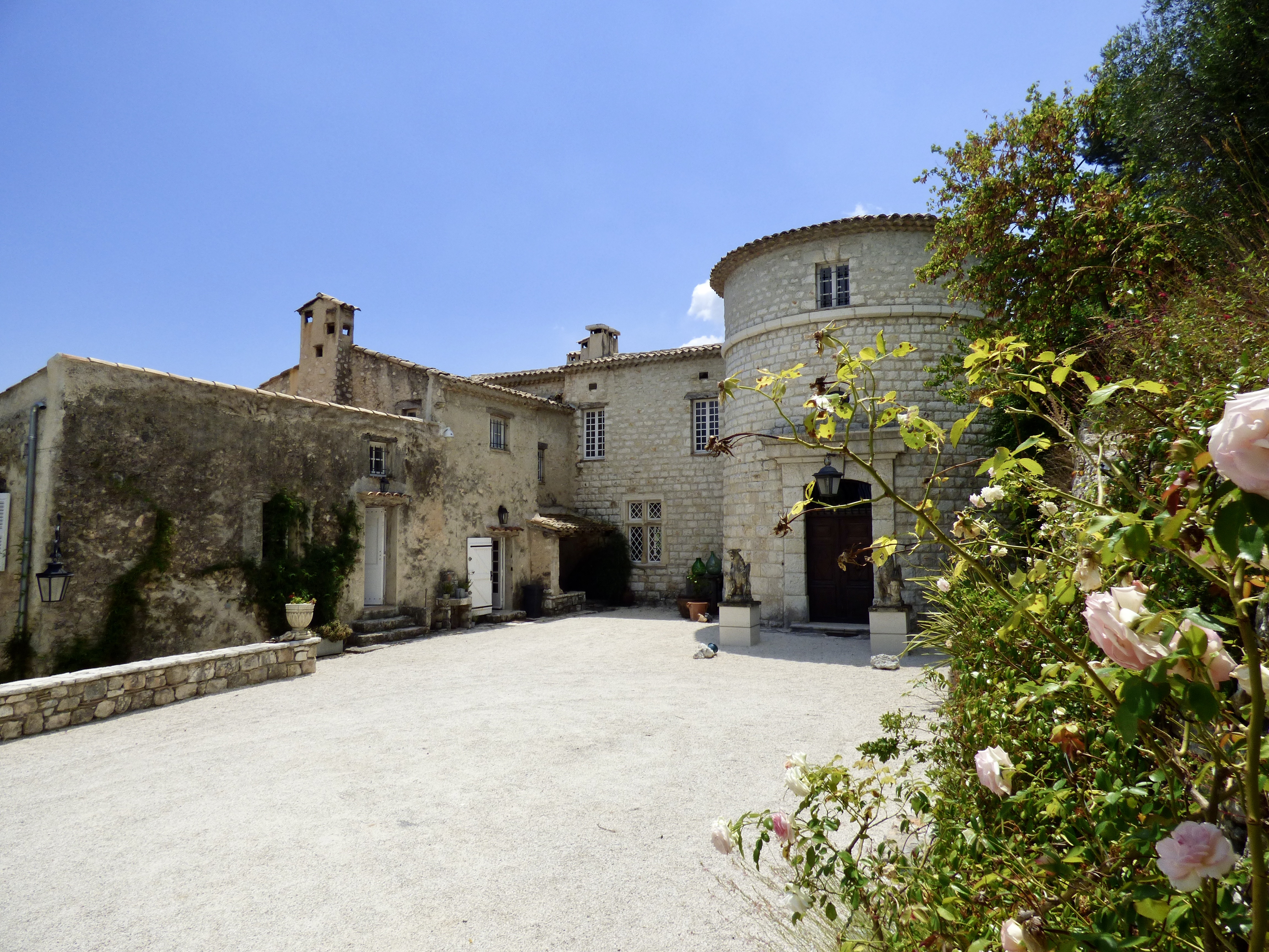 restored french chateau overlooking medieval villages