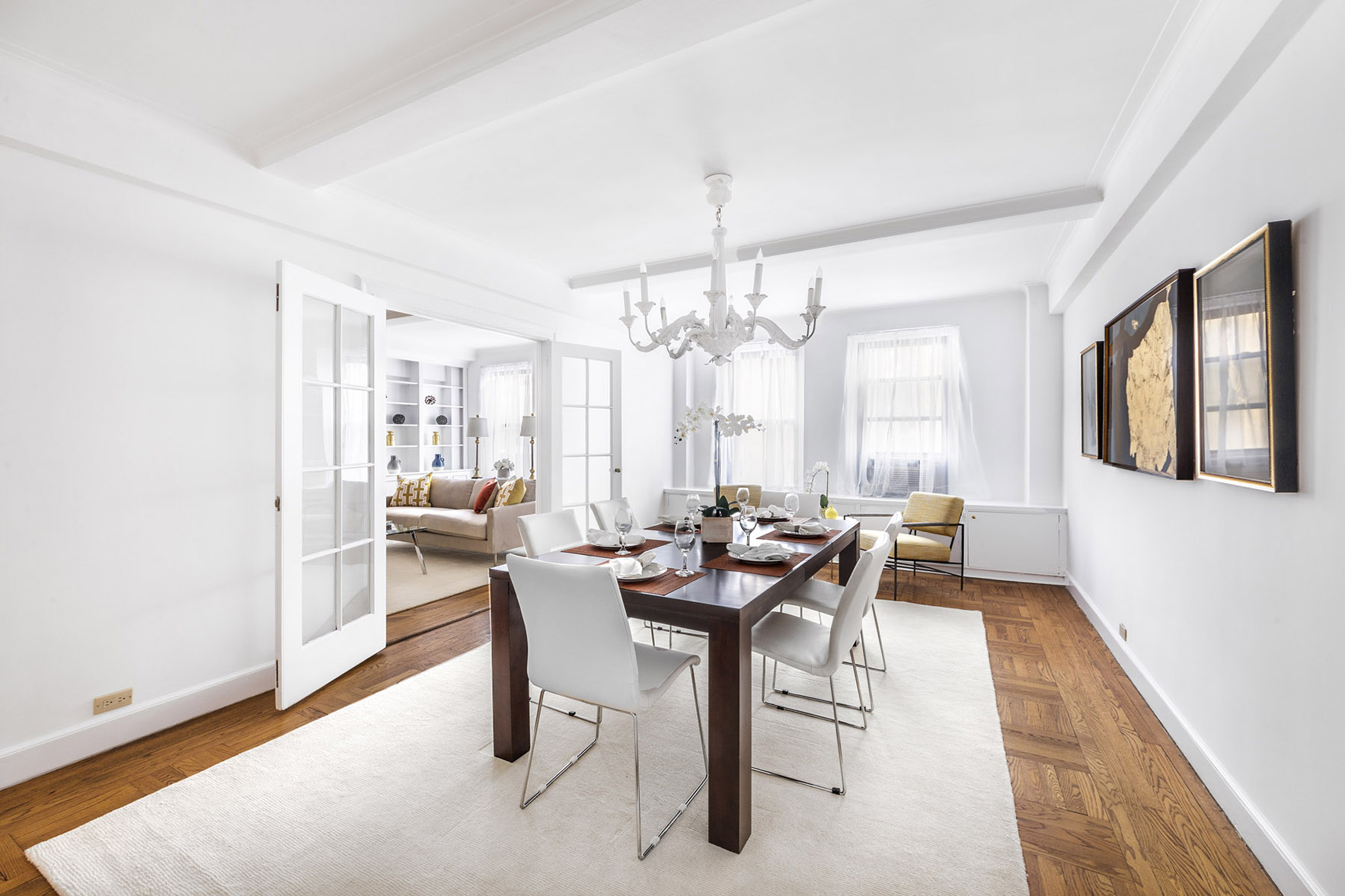 white dining room with sheer curtains in carnegie hill manhattan apartment