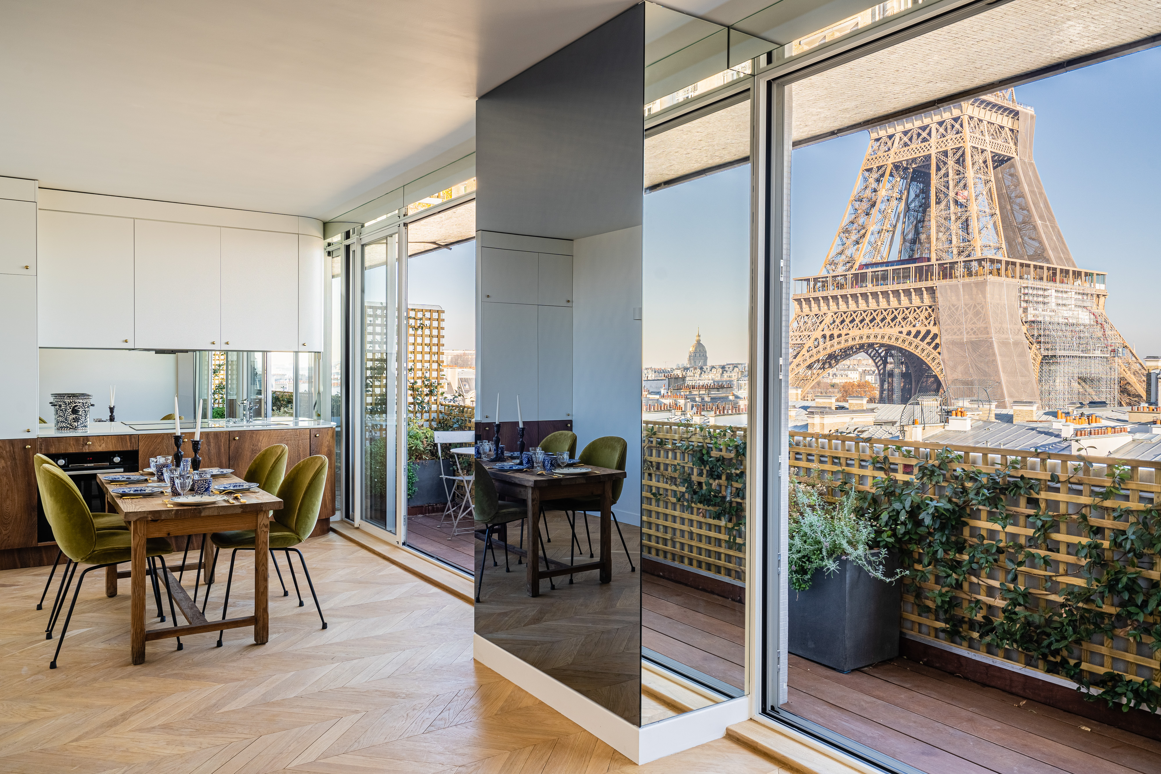 paris apartment living room with view of eiffel tower