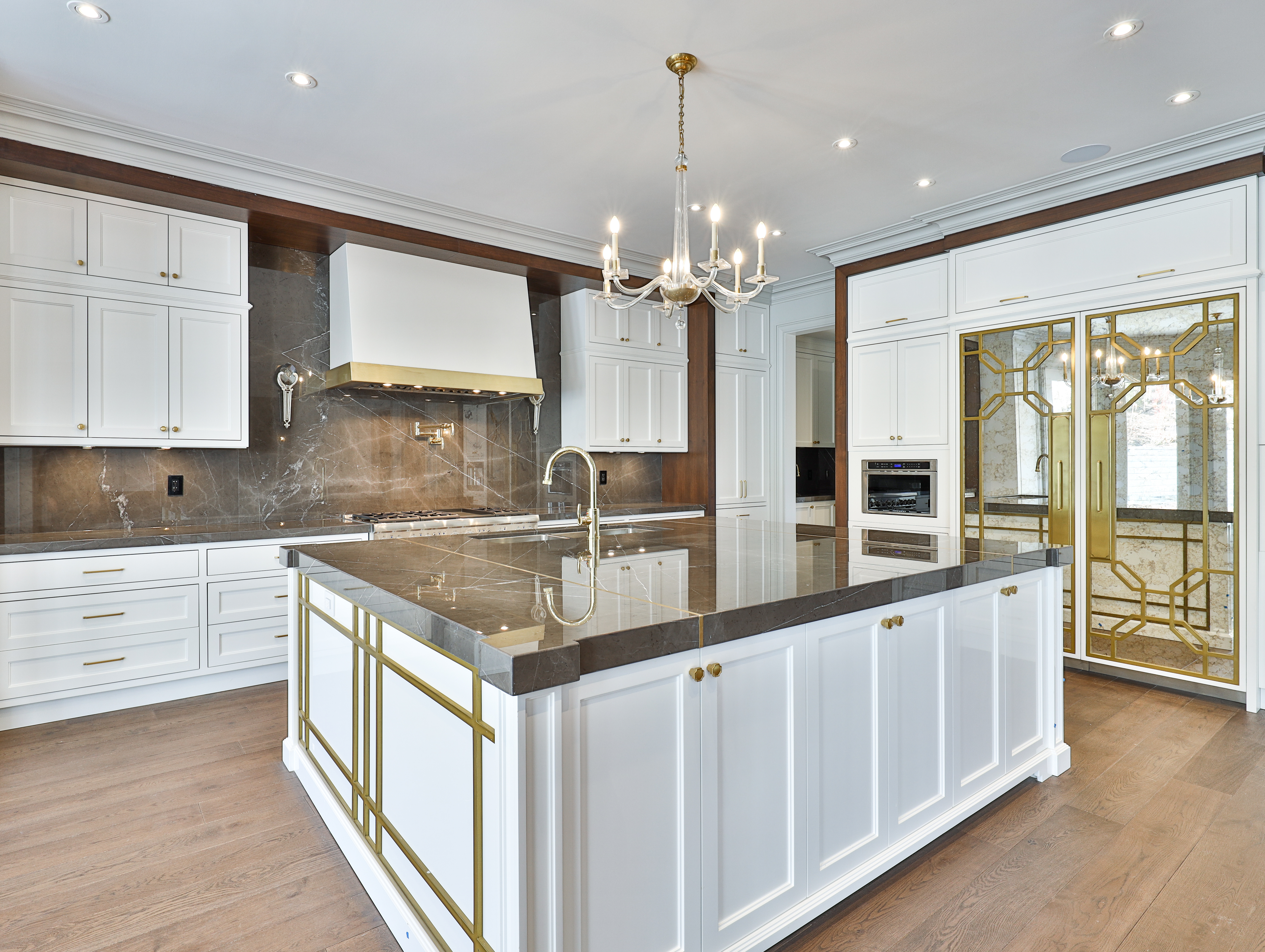 kitchen with gold accents inside toronto luxury home
