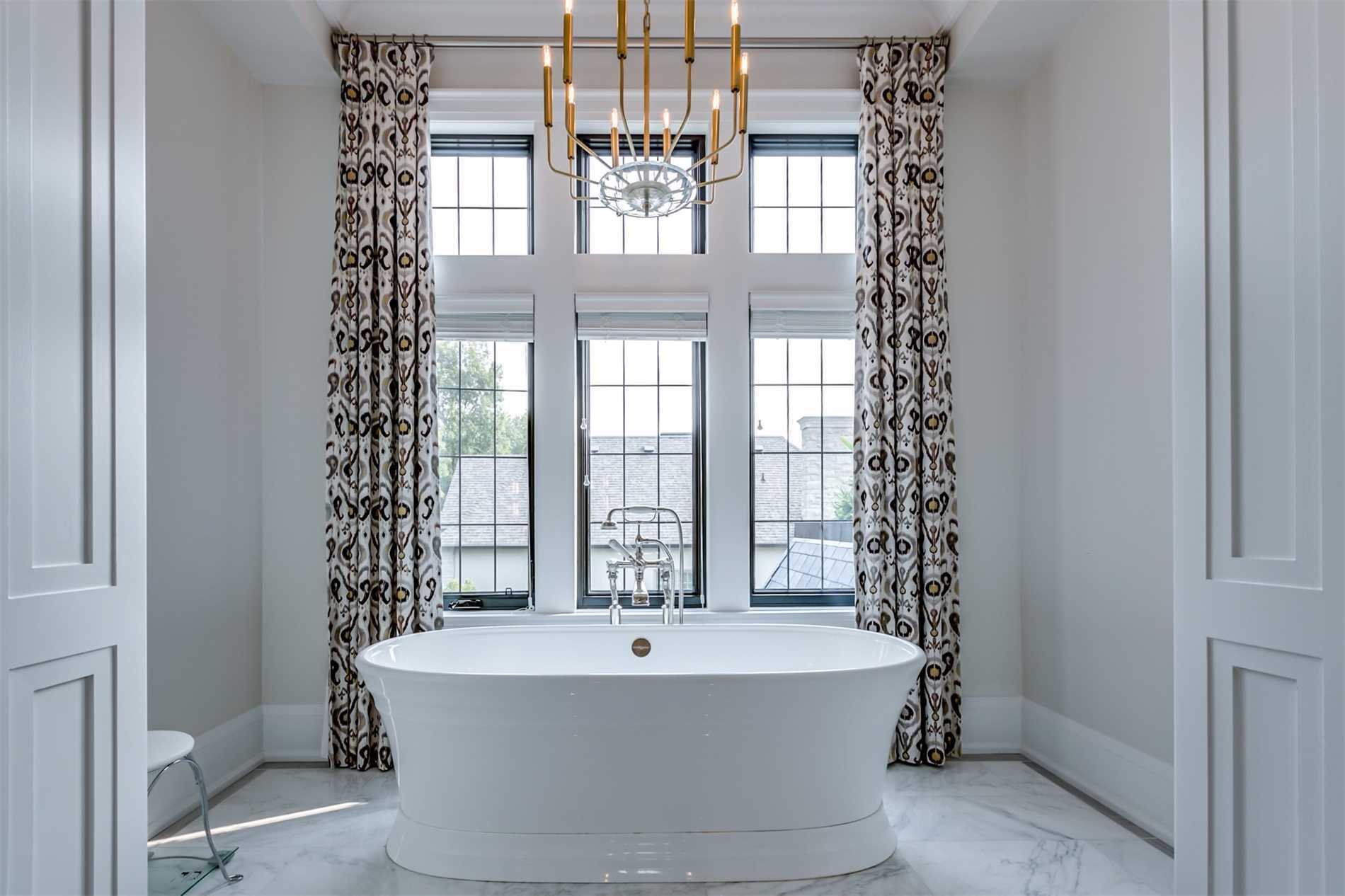 modern candleabra tops a soaking tub inside a luxury york mills estate at 38 York Road