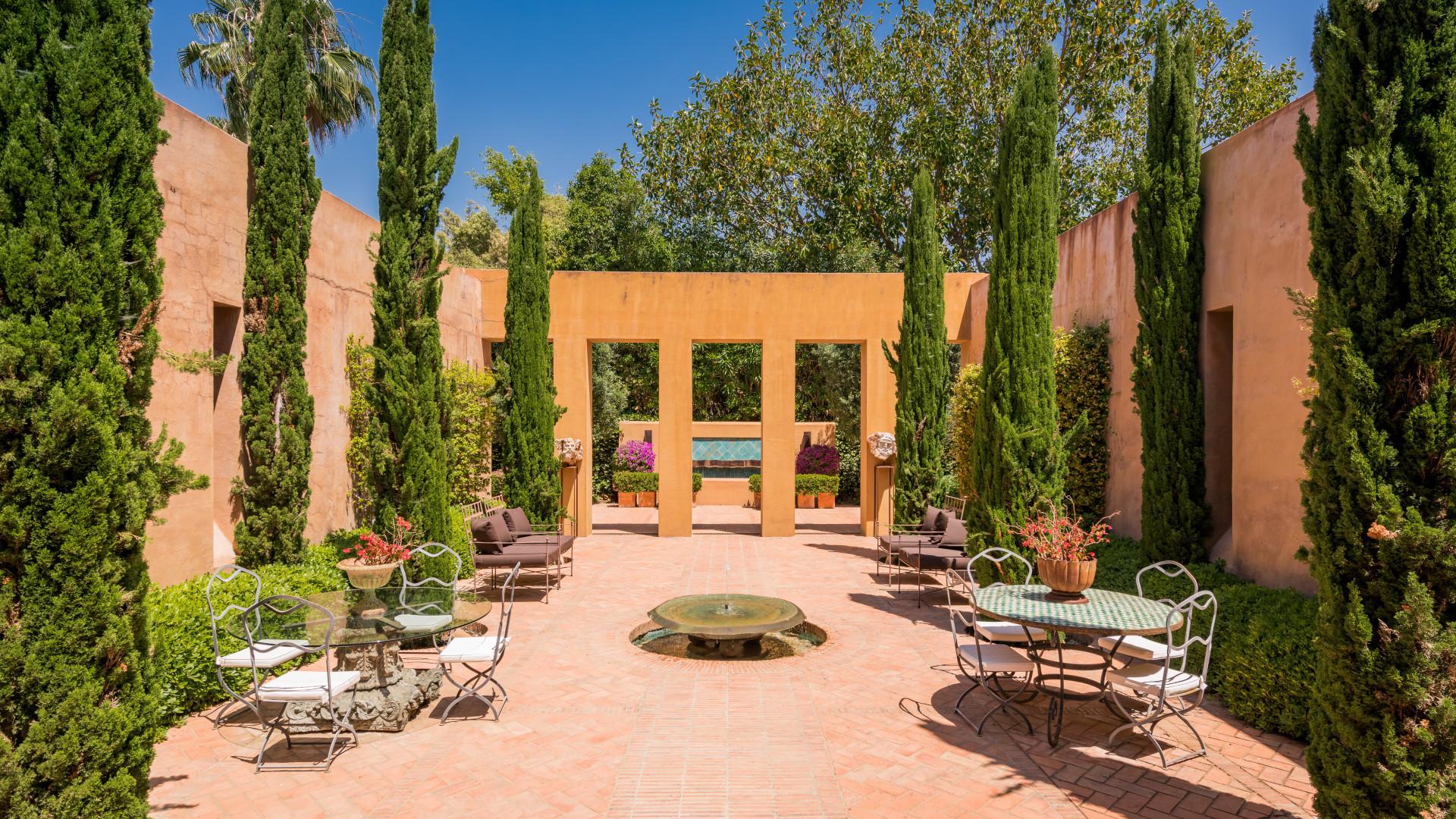 garden courtyard with cypress in villa in San Pedro de Alcantara