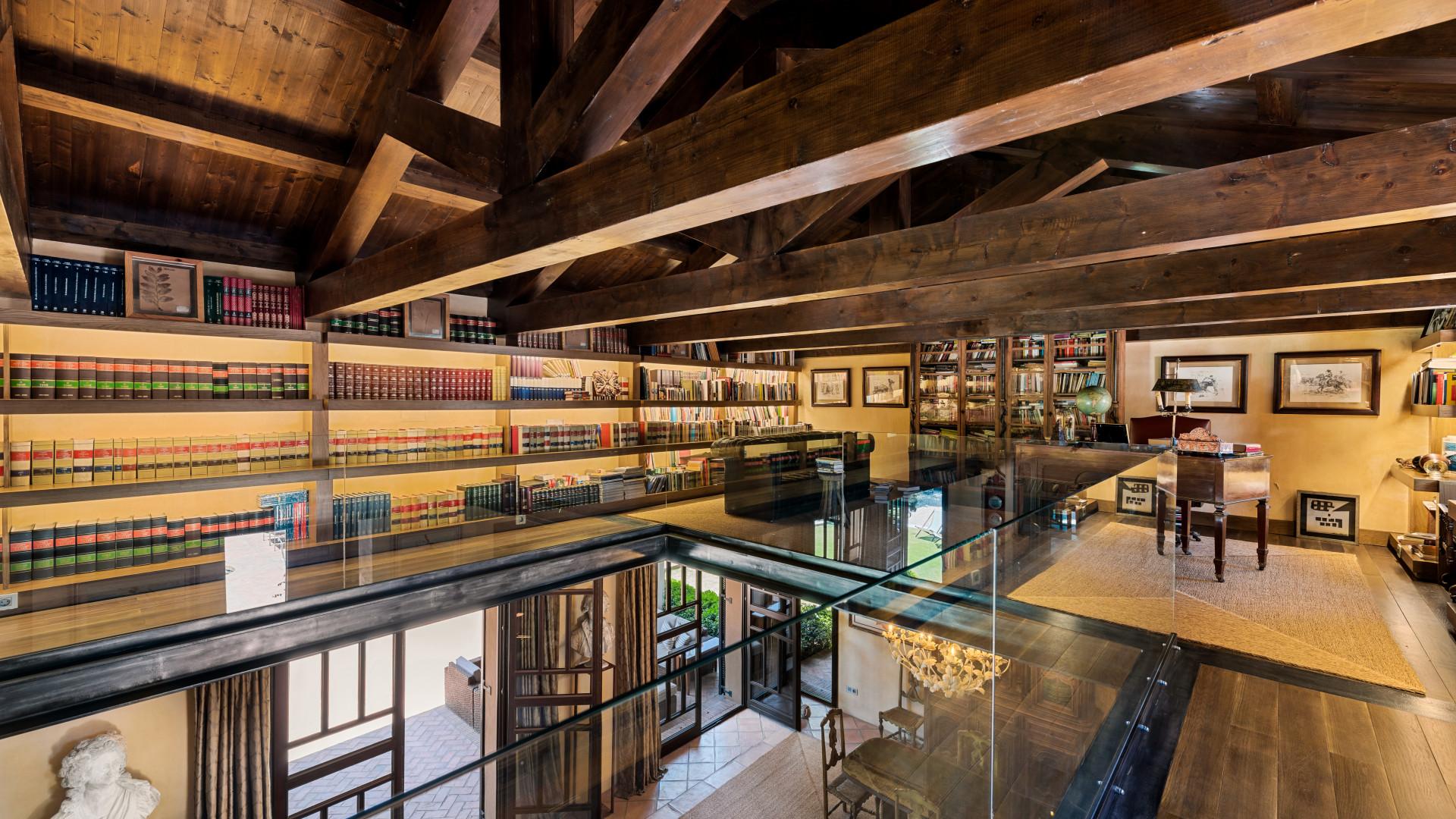 custom modern library in a San Pedro de Alcantara villa for sale