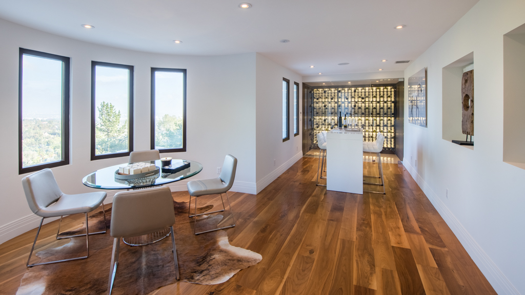 high-end wine room inside 1280 Angelo Dr in Beverly Hills, CA