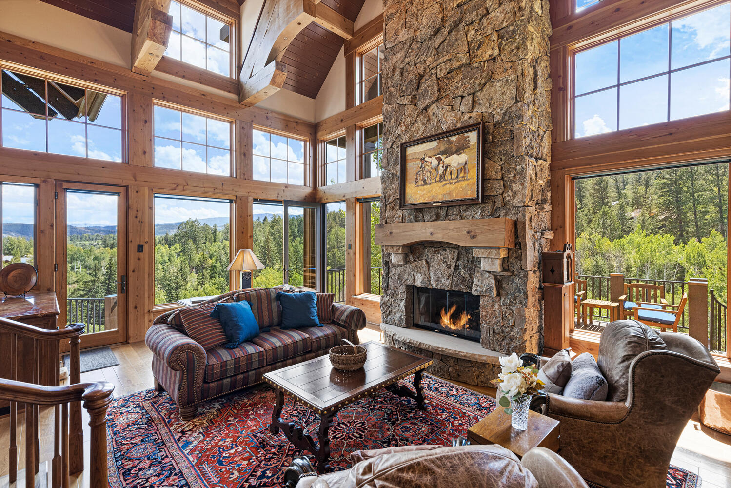 vaulted ceiling living room with mountain views inside 218 Peregrine Drive