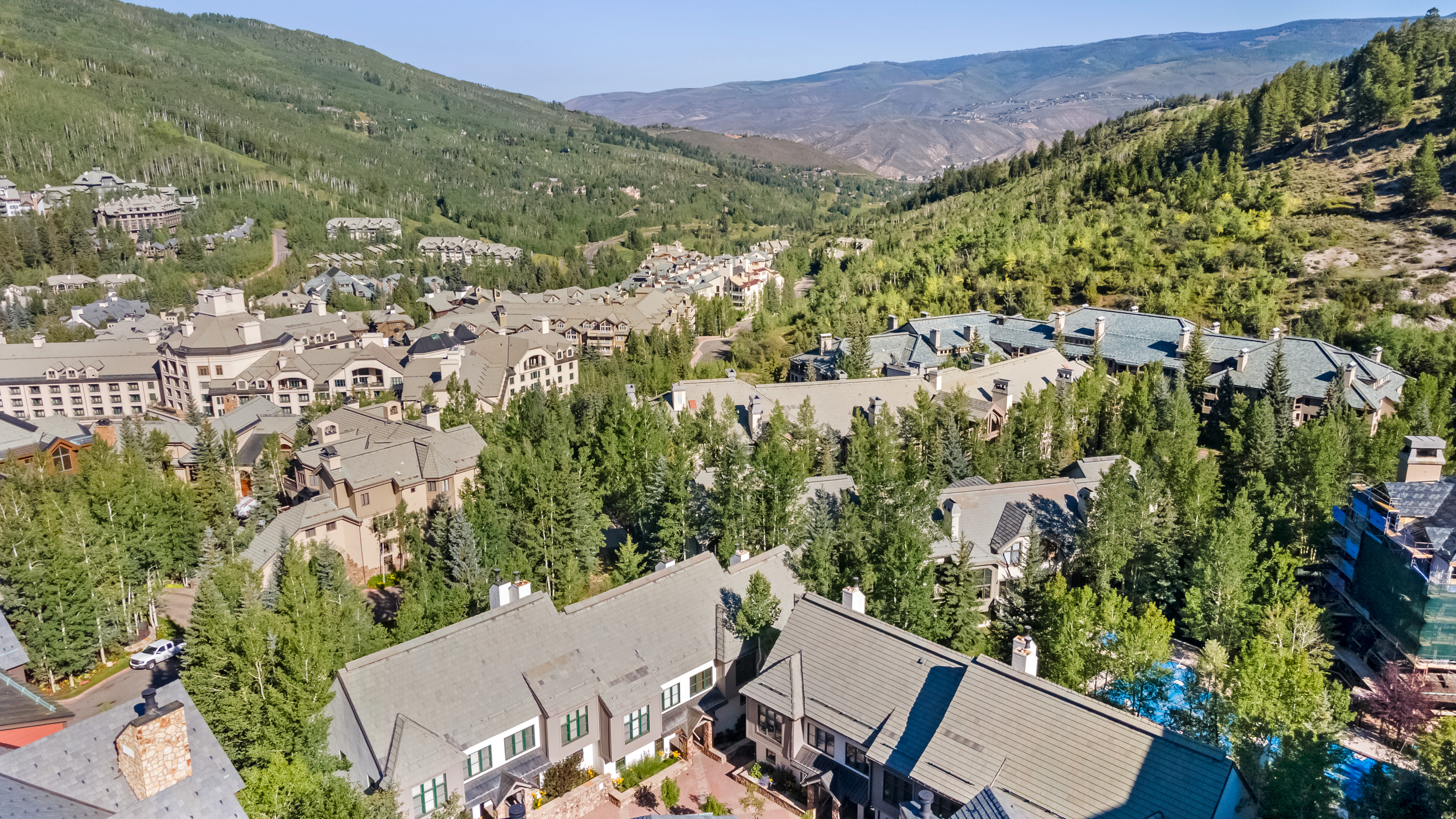 beaver creek aerial view of townhomes, mature trees and mountains